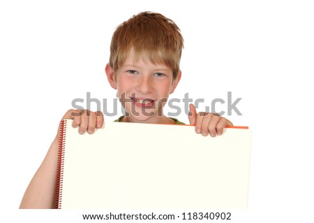 Boy with drawing block in front of a white background