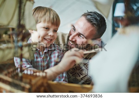 Boy with father - stock photo