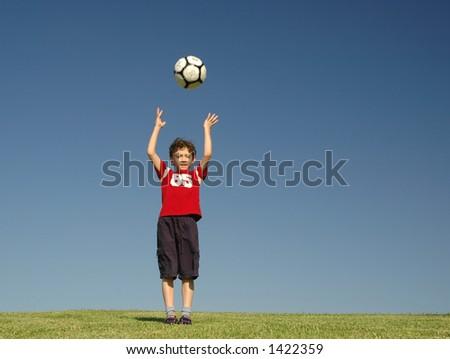 Boy with football - stock photo