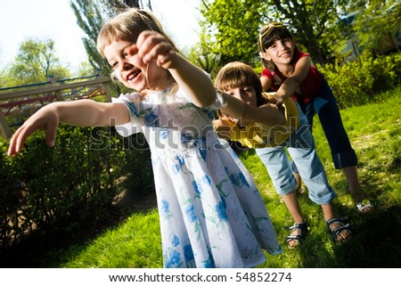 Boy with girls on walk - stock photo