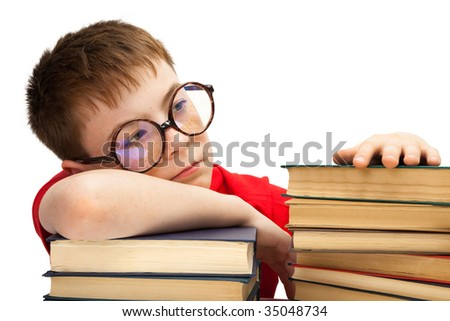 boy with glasses and books on white background
