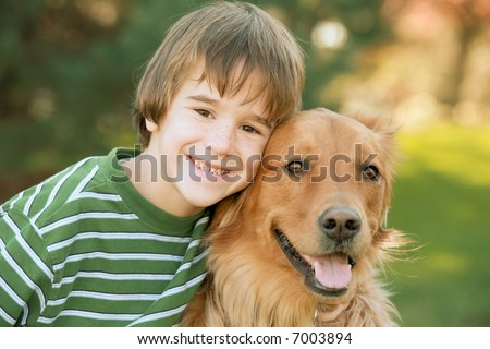 Boy with Golden Retriever - stock photo