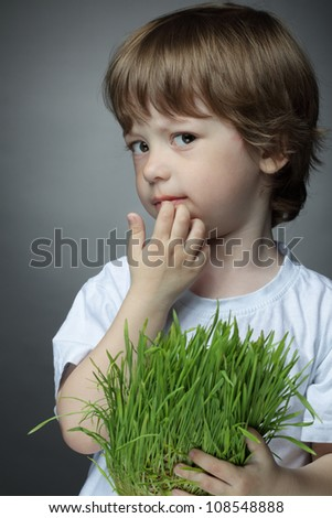 boy with grass, studio shot