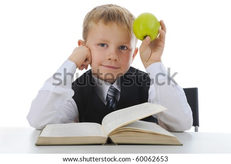Boy with green apple. Isolated on white background - stock photo