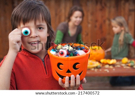 Boy with Halloween stuff preparing for the fright night - stock photo