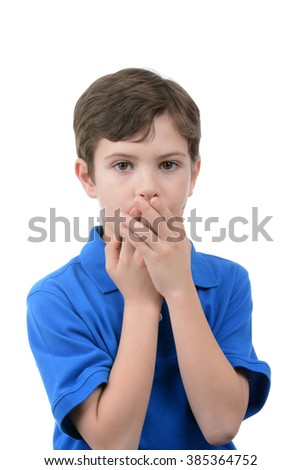 boy with hands over mouth white background - stock photo