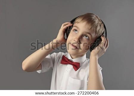 boy with headphones listening to music - stock photo