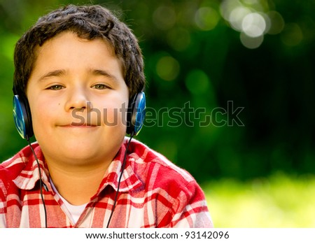 Boy with headphones listening to music outdoors