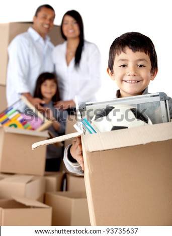 Boy with his family moving house and holding boxes- isolated over a white background - stock photo