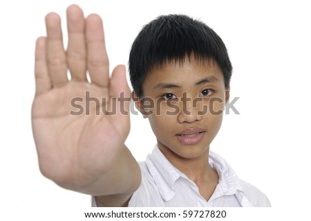 Boy with his hand straight out - stock photo