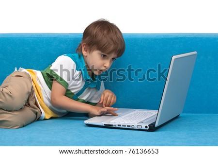 Boy with laptop isolated on white background - stock photo