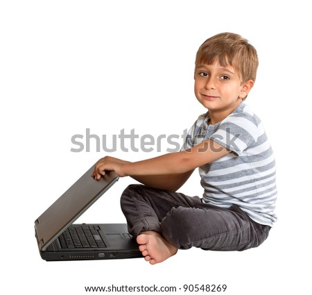 Boy with laptop isolated on white background - stock photo