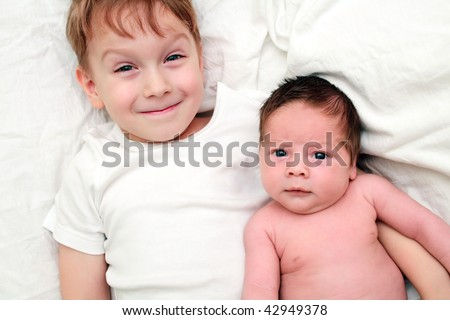 boy with little brother - stock photo