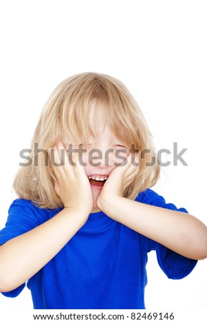 boy with long blond hair in blue top laughing - isolated on white