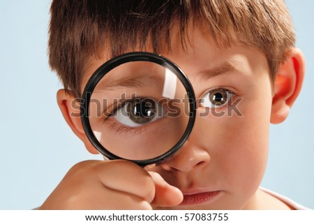boy with looking glass - stock photo