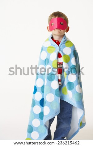 Boy with Mask and Cape - stock photo