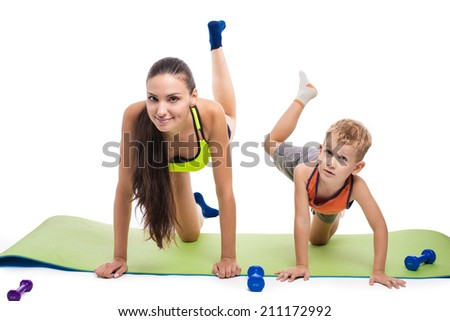 Boy with mother doing gymnastic exercises with dumbbells on a white background - stock photo
