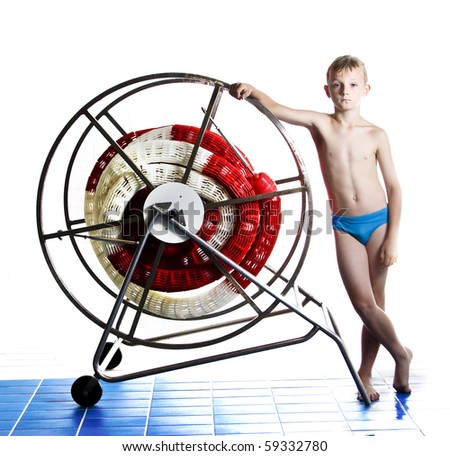 Boy with professional swimming pool equipment - stock photo