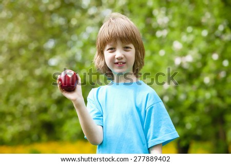 Boy with Red Apple Showing Heart Shaped Bite Off - stock photo