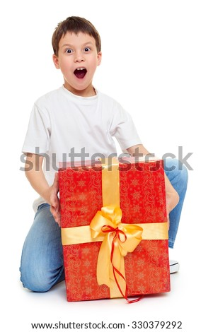 boy with red gift box and golden bow - holiday object concept isolated - stock photo