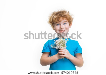 boy with red hair and freckles, ?hild with a bouquet of white flowers in a blue shirt isolated on white background,  son gives mom flowers on Women's Day, Mother's Day, birthday