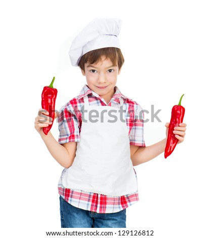 boy with red peppers on a white background - stock photo