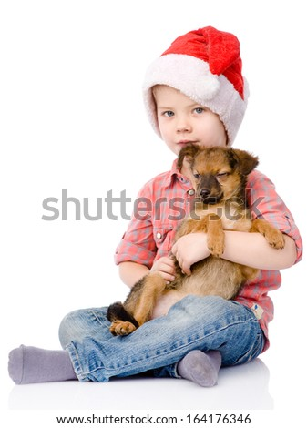 Boy with Santa hat is holding a puppy. isolated on white background - stock photo