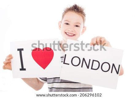 Boy with  sign I love London  . Series of boy with English city signs - stock photo