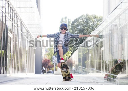 Boy with skateboard in the city