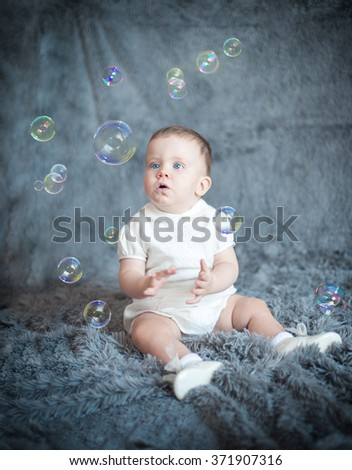Boy with soap bubbles in the studio