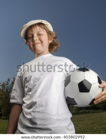 boy with soccer ball - stock photo