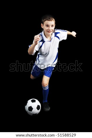 Boy with soccer ball, Footballer on the black background. (isolated)