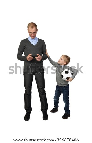 Boy with soccer ball in hand calls adult man to play football isolated on white background - Father and son - sport, leisure and relations in family - stock photo