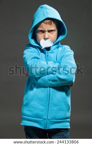 Boy with speech bubble on his mouth. Speechless, sad, violence, despair. - stock photo