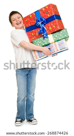 boy with stack of gift boxes - stock photo