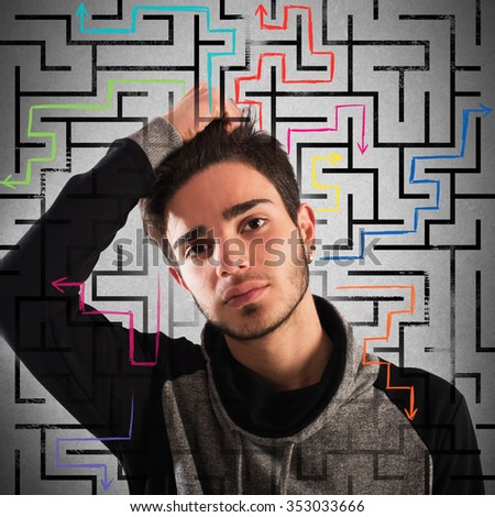 Boy with thoughtful expression with maze background - stock photo