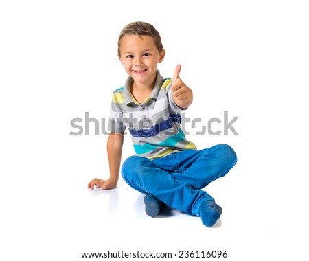 Boy with thumb up over white background - stock photo