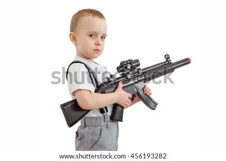 Boy with toy machine gun isolated on a white background.