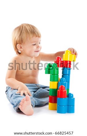 Boy with toys - stock photo