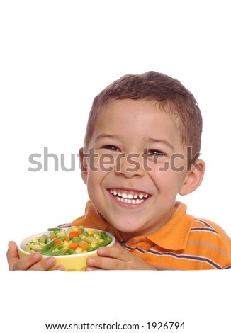 Boy with vegetables - stock photo