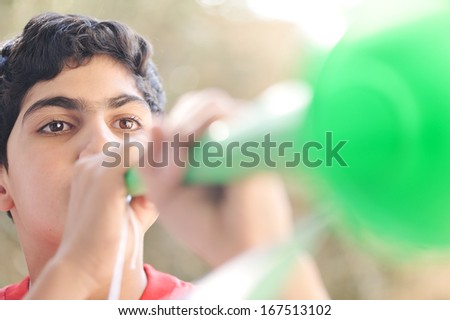 Boy with vuvuzela supporting football team - stock photo