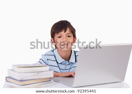 Boy working with a notebook against a white background - stock photo