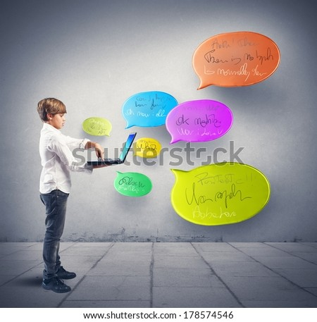 Boy writes messages to social networks with computer - stock photo
