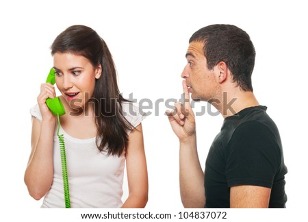 Boyfriend feeling disturbed by the phone calls - stock photo