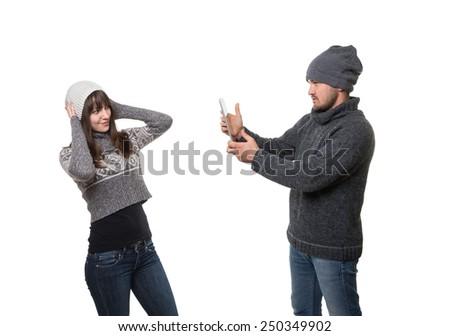 Boyfriend taking picture of his girlfriend - stock photo