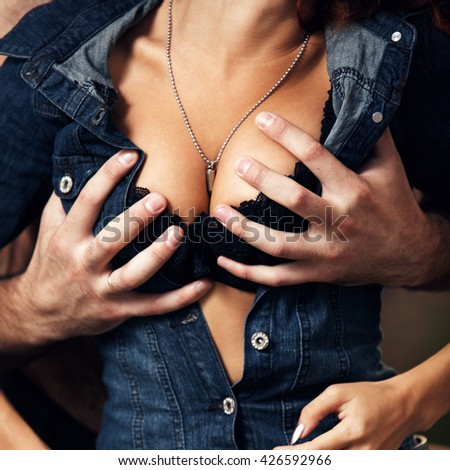 Boyfriend undressing his girlfriend. - stock photo