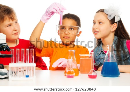 Boys and girls learning chemistry and conduct experiments