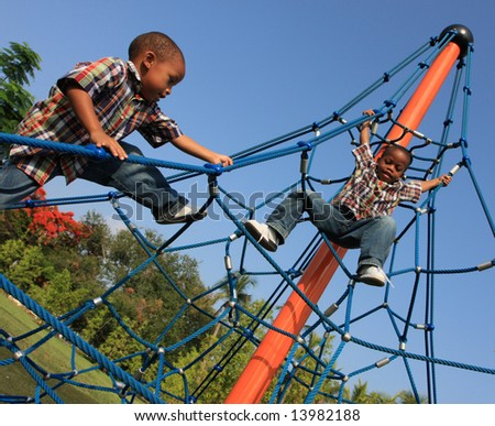 Boys Climbing Ropes - stock photo