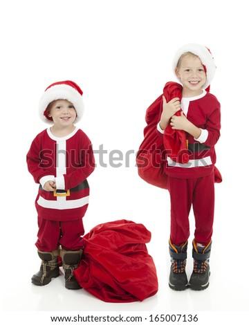Boys Dressing up as Santa - stock photo