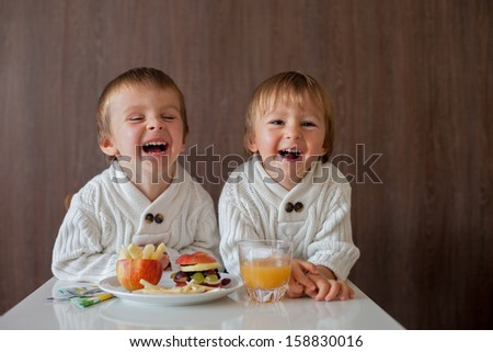Boys, eating fruit sandwich - stock photo